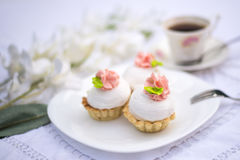 Assorted fancy gourmet cupcakes on a plate. Cupcakes with beautiful decoration over white vintage lace background. Stock Images