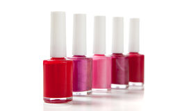 Assorted fingernail polish on a white background Royalty Free Stock Images