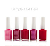 Assorted fingernail polish on white with text Stock Photography