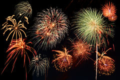 Assorted fireworks. Busting against a black background Royalty Free Stock Photography