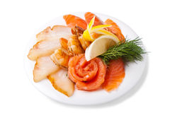 Assorted fish. On a white plate Stock Photo