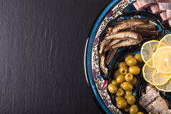Assorted fish on a plate on a dark background. With space for te Stock Photography