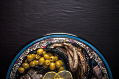 Assorted fish on a plate on a dark background. With space for te Stock Image