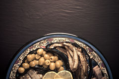 Assorted fish on a plate on a dark background. With space for te Royalty Free Stock Photos