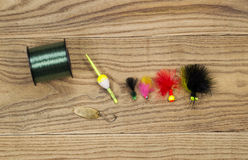 Assorted Fishing Equipment on Faded Wood Royalty Free Stock Photos