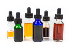 Assorted flavors of vape juice Stock Photos