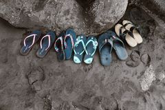 Assorted Flip-flops on Sand royalty free stock image