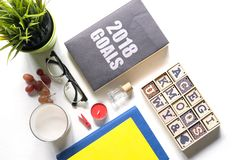 Assorted food and coffee with notebook on the table. royalty free stock images