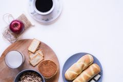 Assorted food and coffee with notebook on the table. stock images