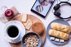Assorted food and coffee with notebook on the table. royalty free stock photography