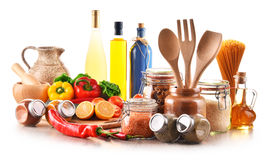 Assorted food products and kitchen utensils isolated on white Royalty Free Stock Photography