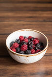 Assorted forest raspberry and blackberry Stock Photos
