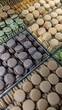 Assorted French macaroons. Assorted French macarons in a bakery case royalty free stock images