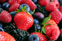 Assorted fresh berries. Background of assorted fresh berries close up Stock Photos