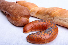 Assorted fresh breads isolated on a white background. Stock Image