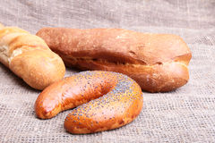 Assorted fresh breads  on old sackcloth. Royalty Free Stock Images