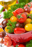Assorted fresh cherry tomatoes, herbs and spices, close-up Stock Photos