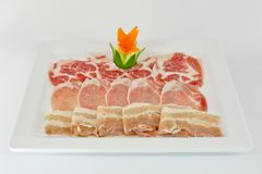 Assorted Fresh Cured Meats on white dish isolate Royalty Free Stock Photography