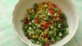 Assorted fresh cut vegetables in a bowl stock video footage