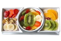 Assorted Fresh Fruit with Yogurt. Fresh fruit salad served along with strawberry greek yogurt topped with strawberries, cereal and bananas, and orange greek royalty free stock image