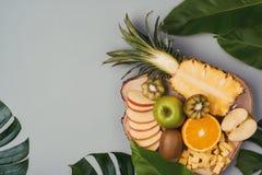 Assorted fresh fruits on plate. Apple, orange, kiwi, pineapple, stock images