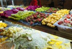 Assorted Fresh Fruits in Storefront. Assorted Fresh Fruits, Strawberry, Kiwi, Dragon Fruit, Fruit Salad with Yogurt in Storefront stock photos