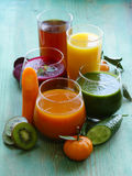 Assorted fresh juices from fruits vegetables Stock Photos
