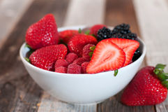 Assorted fresh juicy berries in bowls Stock Images