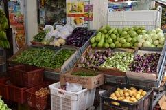 Assorted fresh raw organic vegetables. Composition with assorted fresh raw organic vegetables in Little India market, Singapore Stock Photos