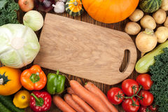 Assorted fresh raw vegetables and cutting board. Top view Stock Photo