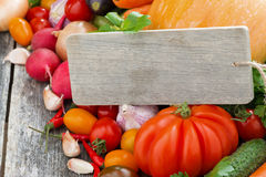 Assorted fresh seasonal vegetables and a wooden nameplate Stock Photography