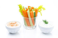 Assorted fresh vegetables in a glass and two yogurt sauce isolated Stock Photo