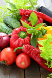 Assorted fresh vegetables and greens on the table Stock Images