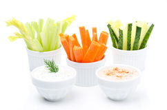 Assorted fresh vegetables and two yogurt sauce Stock Photography