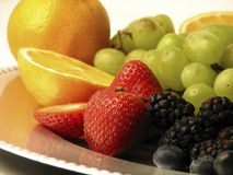Assorted fruit. On a silver plate royalty free stock photos