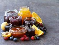 Assorted fruit berry jams Stock Photo