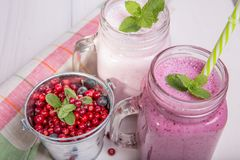 Assorted fruit or berry shakes on white table. Smoothie concept. Assorted fruit or berry shakes on white table. Smoothie healthy eating concept Royalty Free Stock Images