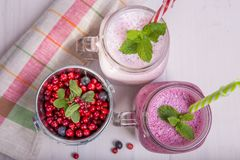 Assorted fruit or berry shakes on white table. Smoothie concept. Assorted fruit or berry shakes on white table. Smoothie healthy eating concept Stock Photos