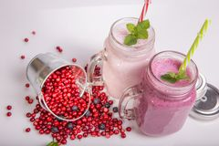 Assorted fruit or berry shakes on white table. Smoothie concept. Assorted fruit or berry shakes on white table. Smoothie healthy eating concept Royalty Free Stock Photography