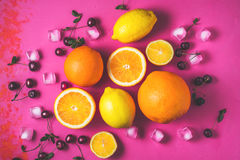 Assorted fruit on the bright pink background horizontal Stock Images