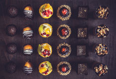 Assorted of fruit and chocolate mini cakes Royalty Free Stock Photos
