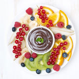 Assorted fruit with chocolate sauce, top view Stock Photos