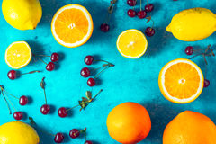Assorted fruit on the cyan background horizontal Stock Photos