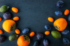 Assorted fruit on the dark stone table  horizontal Stock Images