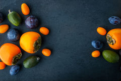 Assorted fruit on the dark stone table Stock Image