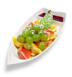 Assorted fruit in a dish in the form of a boat Stock Images