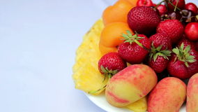 Assorted fruit, fruit still life, fresh berries and fruit on the table stock footage