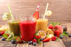 Assorted fruit juice. On wood background royalty free stock photos