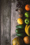 Assorted fruit at the right of the wooden table top view Royalty Free Stock Photos