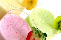 Assorted fruit smoothies Stock Photos